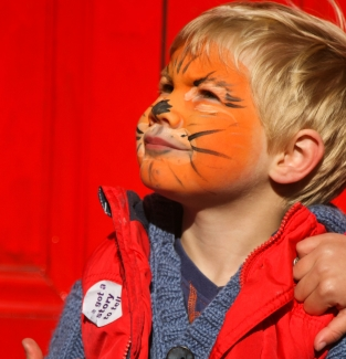 Child with face paint of a tiger