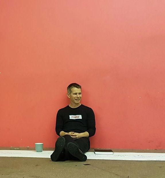 Image of Jason Hird sitting on floor