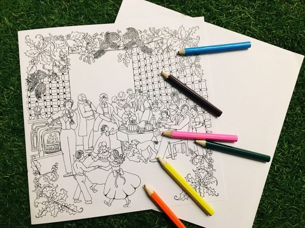 Photo of Christmas colouring cards with coloured pencils