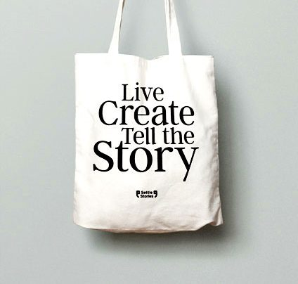 Photo of storytelling tote bag in hand